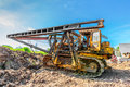 Pile driver on construction site in summer morning Royalty Free Stock Images