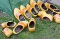 Pile of dutch clog wooden shoes outside in the rain Royalty Free Stock Image