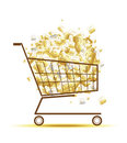 Pile of euro coins in shopping cart Royalty Free Stock Photo