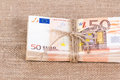 Pile of fifty euro banknotes tied with rope Royalty Free Stock Photo