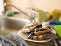 Pile of filthy dishes infested with roaches close up Stock Image