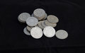 Pile of florins coins old english in a on a black background Royalty Free Stock Photo