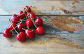Pile of fresh cherries red against wooden background Stock Photography