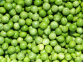 Pile of fresh peas green background Royalty Free Stock Photo