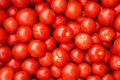 Pile of fresh tomatoes red background at the market Royalty Free Stock Photos