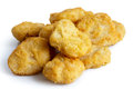 Pile of frozen battered chicken nuggets uncooked and isolated on white in perspective Royalty Free Stock Image
