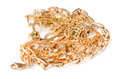Pile of gold jewelry on white background chains necklaces bracelets earrings rings and other scrap Stock Photos