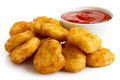 Pile of golden deep fried battered chicken nuggets with bowl of ketchup isolated on white Royalty Free Stock Photography