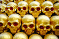 Pile of golden skulls with red eyes. closeup Royalty Free Stock Photo