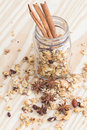 The Pile of granola cereal and cinnamon sticks on the wood backgroun Royalty Free Stock Photo