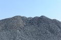 Pile of gravel a large against a blue sky Royalty Free Stock Image