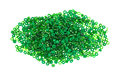 Pile of green glass craft beads a small used in arts and crafts on a white background Royalty Free Stock Image