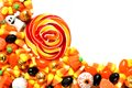 Pile of halloween candy over white colorful and sweets corner border a background Royalty Free Stock Photography