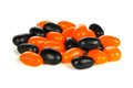 Pile of halloween orange and black jellybeans over white a background Stock Image