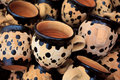 Pile of Handpainted Red Clay Coffee Mugs Stock Images