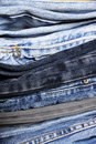 Pile of jeans cloe up on a with their different colors and textures Stock Photography