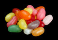 Pile of jelly beans isolated on black background candy in various colors Stock Photo