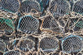 Pile of lobster pots background created by closeup a showing metal framework net made string and lengths rope to fix to a Stock Photography