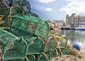 Pile of lobster pots on kirkwall harbour stacked top each other with orkney in the background Royalty Free Stock Photography