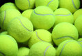 Pile of loose tennis balls close up Royalty Free Stock Images