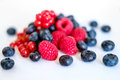 Pile of mixed berries on white background Royalty Free Stock Photo