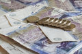 Pile of money and stacked coins british pounds sterling gbp Royalty Free Stock Photo