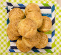 Pile of muffins. Muffins in a pile on a colorful striped napkin. Royalty Free Stock Photo