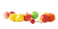 Pile of multiple artificial plastic fruits and berries isolated over the white background Stock Photos