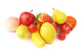 Pile of multiple artificial plastic fruits and berries isolated over the white background Stock Image