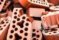 Pile of new but beaten silicate bricks closeup Stock Photography