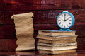 Pile of old books with alarm clock Royalty Free Stock Photo