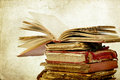 Pile of old books vintage photo with open one on top Royalty Free Stock Photos
