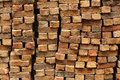 Pile of old bricks gathered from a fallen wall in the garden Royalty Free Stock Images