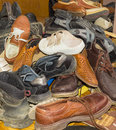 Pile of old different worn footwear Royalty Free Stock Photo