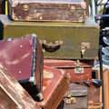 Pile of old vintage suitcases luggage close up Royalty Free Stock Image