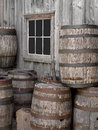 Pile of old wooden barrels by a wall. Royalty Free Stock Photos