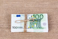 Pile of one hundred euro banknotes tied with rope Royalty Free Stock Photo