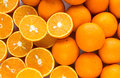pile of oranges sliced and whole Royalty Free Stock Photo