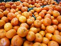 Pile of organic oranges for sale at local farmers market,Fresh m Royalty Free Stock Photo