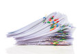 Pile of paper with colorful clips Royalty Free Stock Photo