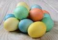 Pile of pastel easter eggs closeup a on a rustic farmhouse style table horizontal format Royalty Free Stock Photo