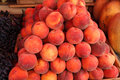 Pile of peaches photography ripe at the market Stock Photography