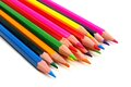 Pile of pencil crayons cluster colorful coming from corner over a white background Royalty Free Stock Image