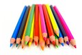 Pile of pencil crayons cluster colorful over a white background Royalty Free Stock Image