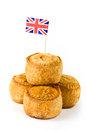 Pile of pork pies with union jack flag Royalty Free Stock Photo