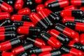Pile of red-black capsule pills. Antibiotics resistance. Drug use with reasonable. Global healthcare concept. Antibiotics drug