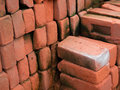 PILE OF RED CLAY BRICKS