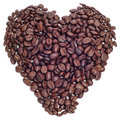 Pile roasted coffee beans forming heart black background Royalty Free Stock Images