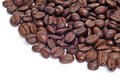 A pile of roasted coffee beans on a white background Stock Photography