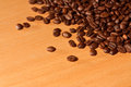 A pile of roasted coffee beans on a wooden table Royalty Free Stock Photo